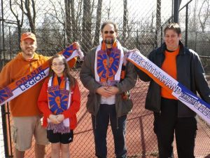 Some Legion members show off the 2014 scarves they picked up today.